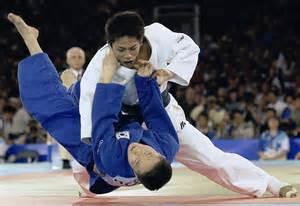 Tadahiro nomura throws south korea s jung bu kyung to win 60 kg judo