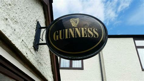 large wall mounted light  guinness pub sign  ipswich