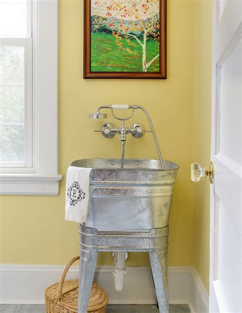 wash laundry in bathtub laundry room with vintage galvanized sink with a hansgrohe