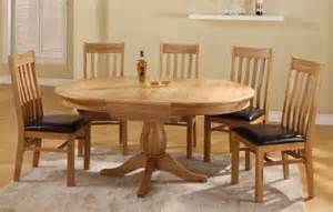 Round to oval extending dining table 6 or 8 vermont oak leather dining