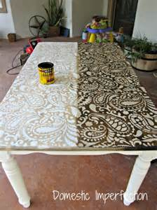 Next i decided to stain over the stencil and give the table a more