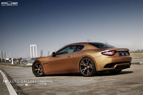 gold maserati granturismo golden maserati granturismo lowered on matching pur wheels