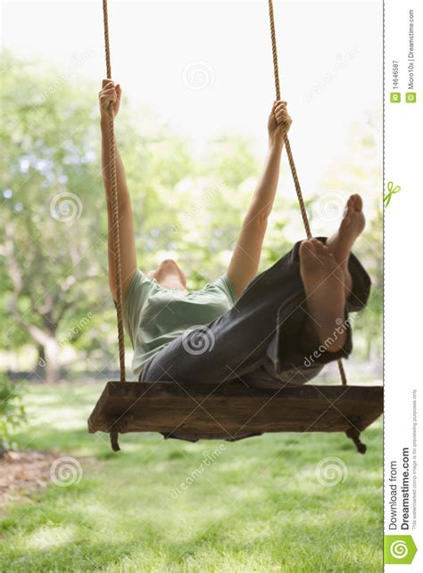 woman on a swing woman swinging on swing royalty free stock photography