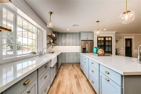 white kitchen cabinets with gold hardware blue shaker cabinets with gold hardware transitional