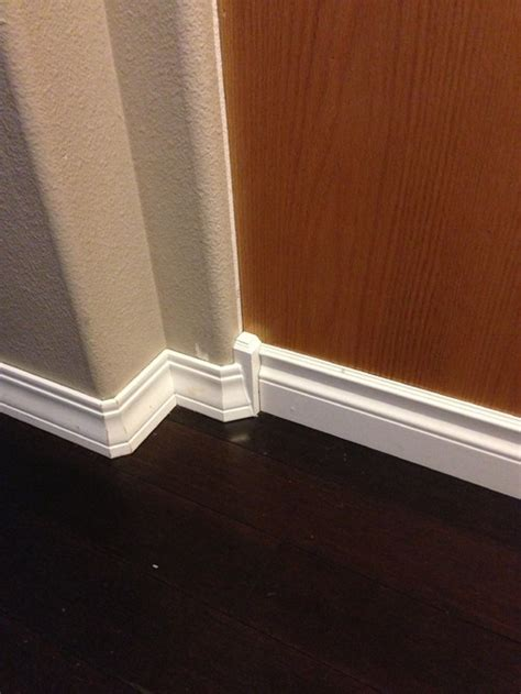 Baseboard Different Floor Heights by How Do I Transition From White To Espresso Moulding And