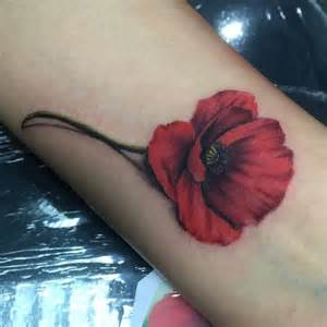 Wonderfully tattooed on her wrist poppy seed can be seen easily