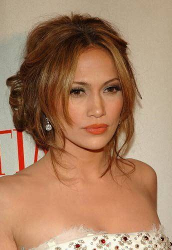 off center part hairstyles jennifer lopez shows off this soft updo that is loosely