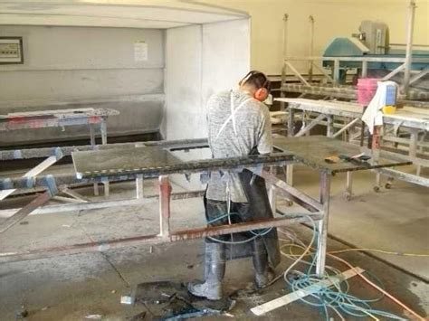 Granite Fabricators Cutting Out A Sink In A Granite Fabrication Stocker