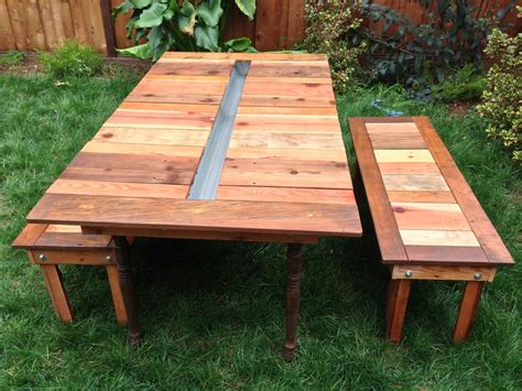 garden bench with table in middle outdoor backyard picnic table with ice cooler box in the middle plus detached bench