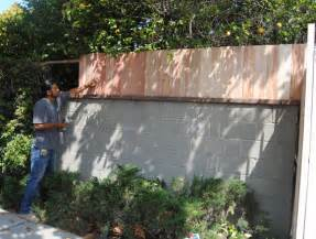 Backyard Fence Options Raise The Height Of Your Backyard Wall By Adding A Fence