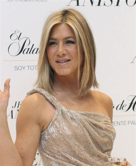 19 stages of jennifer aniston s famous hair throughout the