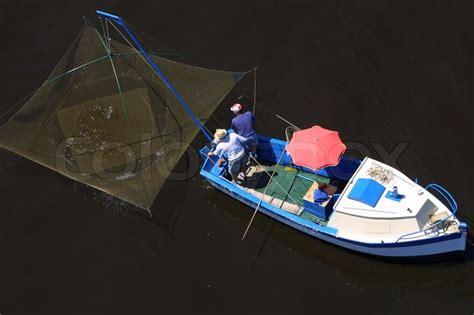 fishing boat top view top view of two men sailing in fishing stock photo