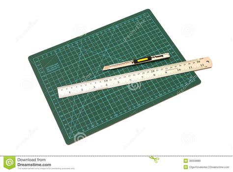 green cutting mats with iron ruler and cuter royalty free