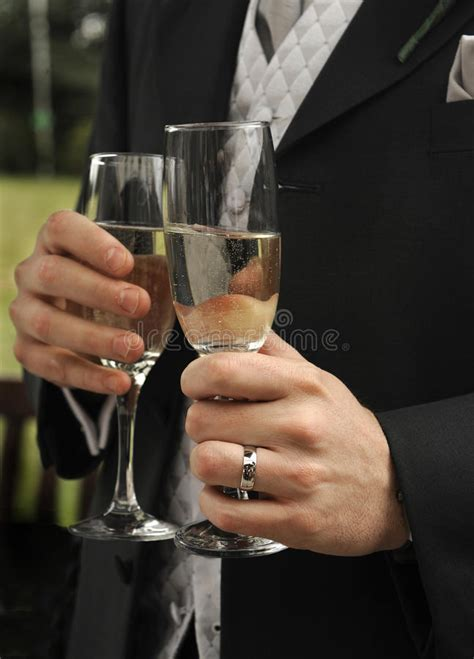 mens hands  champagne glasses stock images image