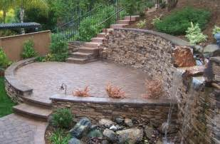 Paver Patio With Retaining Wall The 2 Minute Gardener Photo Tumbled Paver Patio With Veneer Covered Retaining Wall