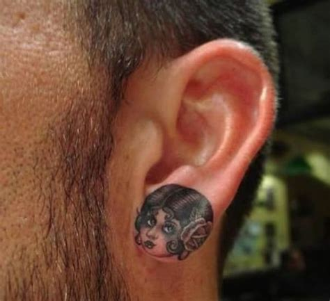 weird tattoo designs 30 and ear tattoos designs