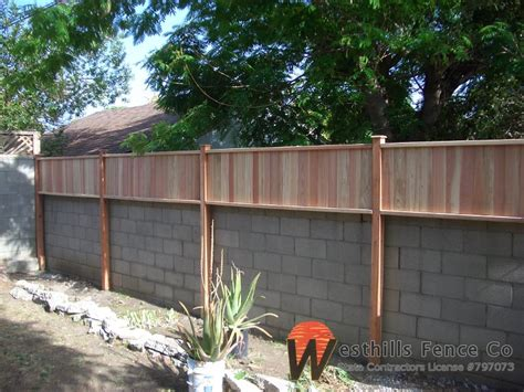 Tongue and gvoove redwood fence on top of wall