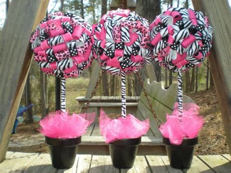 leopard centerpiece ideas ribbon topiary in zebra leopard pink black