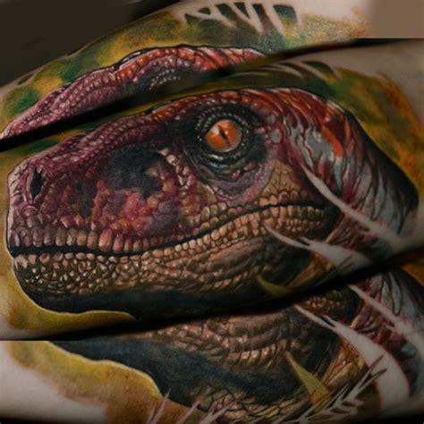 velociraptor tattoo go jurassic with these dinosaur tattoos tiny dino guff