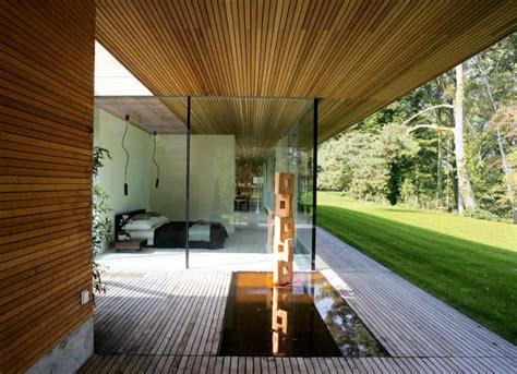 Bungalow Aus Holz by Architektenh 228 User Ruhepol Wasserbassin Bild 9