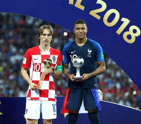 kylian mbappe golden ball luka modric with the golden ball and kylian mbappe with