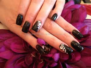 Nails with black gel polish and swarovski crystals nailart nails
