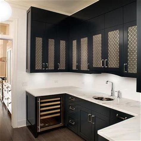 pale aqua pantry door white shaker cabinets black stainless steel glass front butler pantry cabinets
