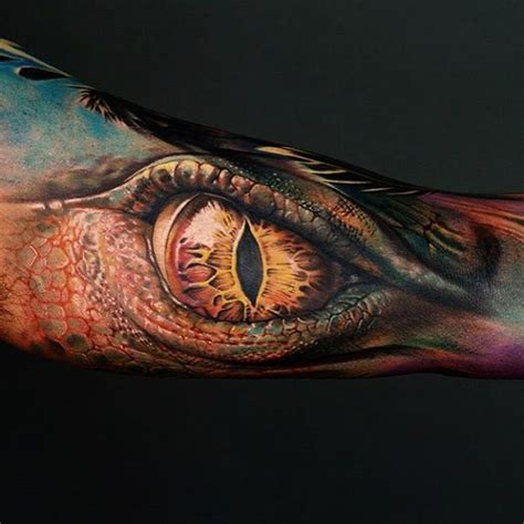 cross tattoo next to eye meaning 1000 ideas about dragon tattoos on pinterest dragon