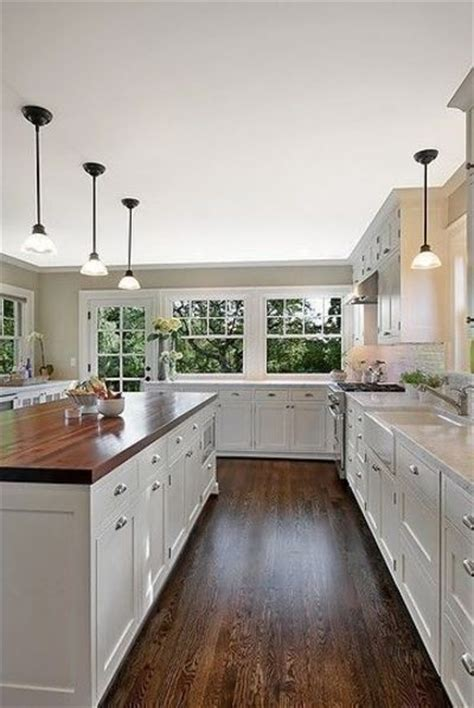 white kitchen cabinets with hardwood floors white cabinets hardwood floors butcher block