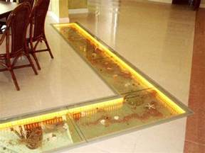 Glass floor tiles with sand and sea shells under them