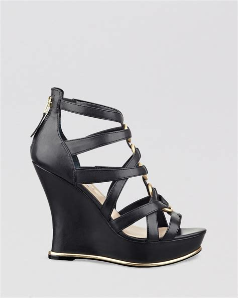 guess wedge shoes guess platform wedge sandals barran in black lyst