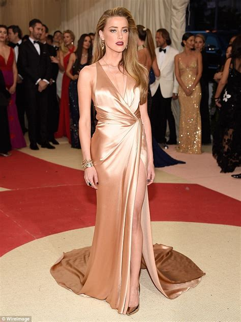 amber heard shimmers in silky gown with thigh high split