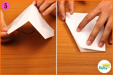 Folding Paper In Half - how to make a paper airplane that flies far page 3 of 4