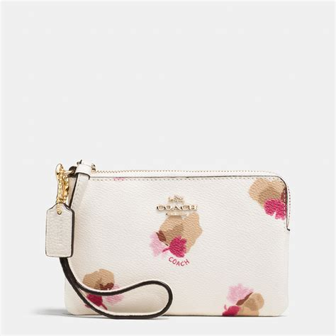 Coach Flowery coach corner zip wristlet in floral print coated canvas in lyst