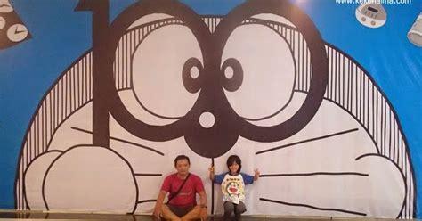 Kaos Doraemon Duduk demam doraemon keke naima