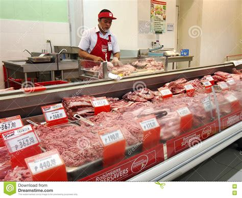 supermarket meat section a butcher at a meat section of a grocery store editorial