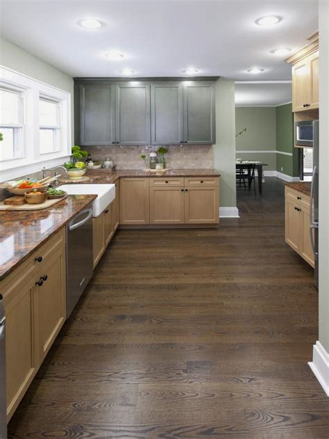 country kitchen with natural and painted green cabinetry