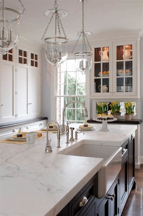 white kitchen cabinets with white marble countertops this classic kitchen features white cabinetry around the
