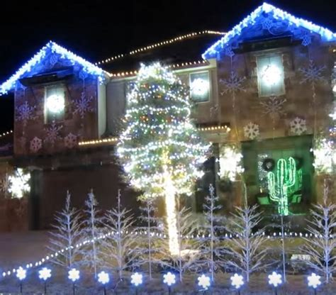 homeowner decorates home with christmas lights to play