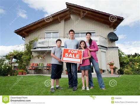 their home family selling their home holding for sale sign royalty