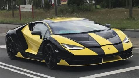 yellow and black lamborghini black and yellow lamborghini centenario on the road in