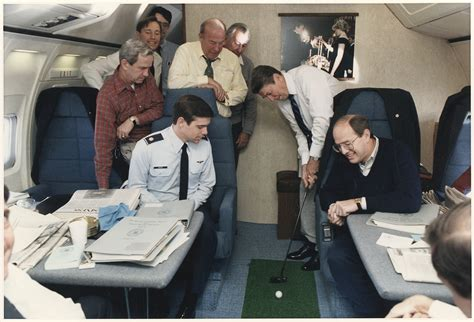 ronald air one interior with file photograph of president putting a golf