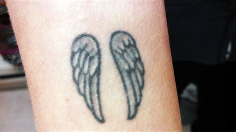 small angel wings tattoos wing tattoos on wrist cool tattoos bonbaden