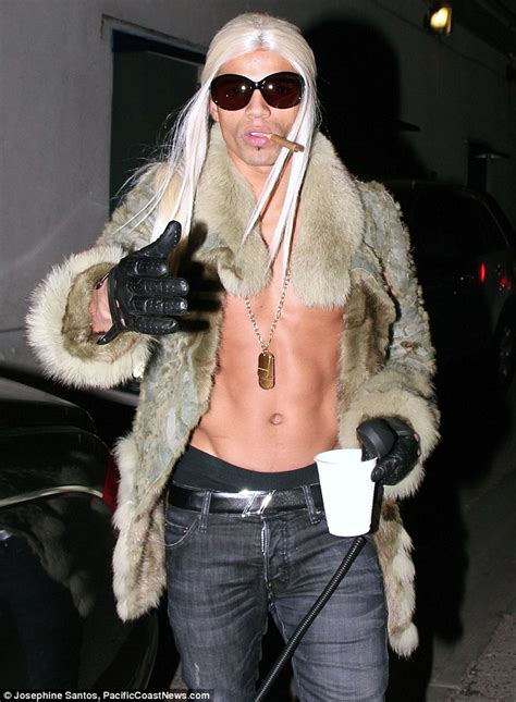 madonna in a fur coat what a switch madonna wears black fright wig and carries