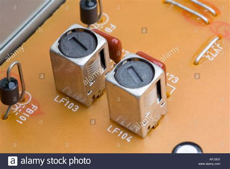 the inductor in a radio receiver carries a current of litude rf coils on a fm radio receiver circuit board intermediate frequency stock photo royalty free