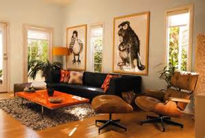 Orange Sofa Living Room White Living Room With Black Sofa Brown Eames Lounge Chair Orange Table And Large Pictures