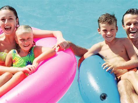 kids naturist family swimming pool fun