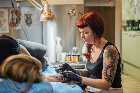 how much to tip your tattoo artist tipping a or piercing artist