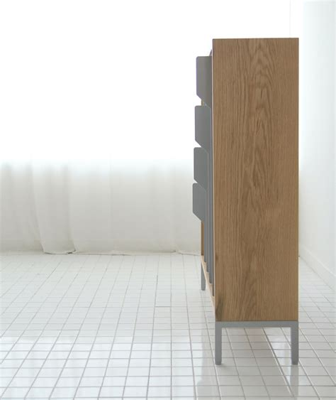 tab sliding bookcase by studio ej