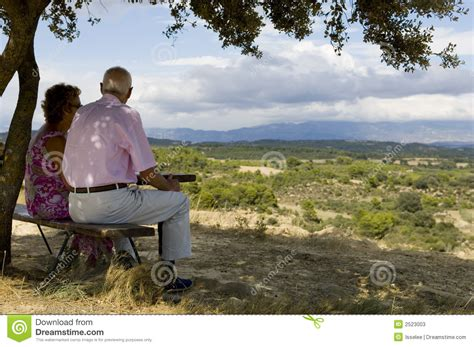 couple sitting on bench old couple stock image image of nature sitting